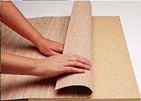 Applying a wood veneer to an all wood               base